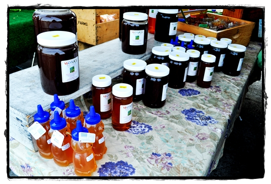 raw honey table at the farmer's market