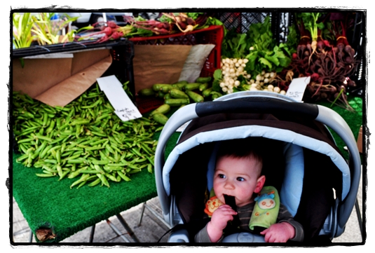 peas and toddler at farmer's market