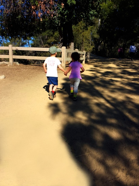 Kids running up Charlie Turner Trail